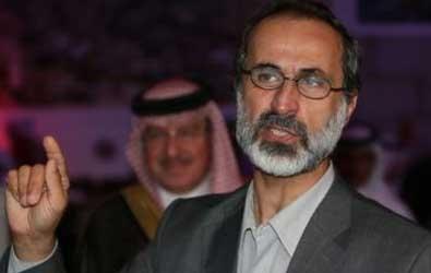 الخطيب يدعو بشار الاسد لبدء المحادثات بشأن رحيله عن السلطة