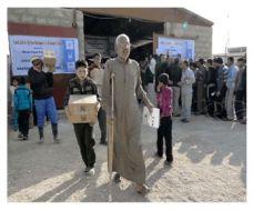 برنامج الأغذية العالمي في العراق يبدأ بتوزيع الطرود الغذائية إلى اللاجئين السوريين