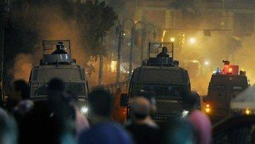 في اشتباكات أمام كاتدرائية الأقباط بالقاهرة .. مصرع شخص و إصابة العشرات