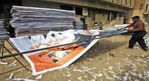 الدملوجي : مكتب القائد العام للقوات المسلحة يأمر بتمزيق الملصقات الانتخابية للعراقية