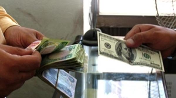 البنك المركزي يضع خطة لرفع سعر صرف الدينار العراقي أمام الدولار ..