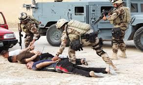قوة حكومية تعتقل عضو المجلس المحلي لناحية الخالدية وشقيقه شرق الرمادي