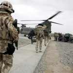 British soldiers walk to a RAF Chinook helicopter for transport in Lashkar Gah, Helmand province
