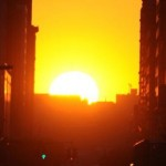 The sun sets along 34th Street, aligning
