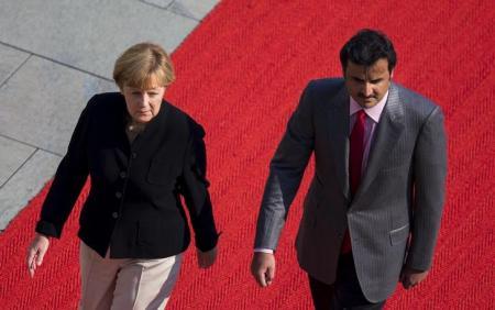 أمير قطر يؤكد لميركل أن بلاده لا تمول المتشددين في سوريا والعراق