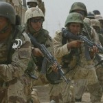 Iraqi soldiers take combat position duri