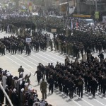 Mehdi Army fighters loyal to Shi'ite cleric Moqtada al-Sadr march during a parade in Najaf