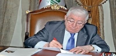 الرئيس العراقي يصادق على قانون العمل