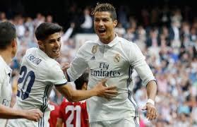 مدريد يسحق اشبيلية برباعية ويقترب من حمل اللقب