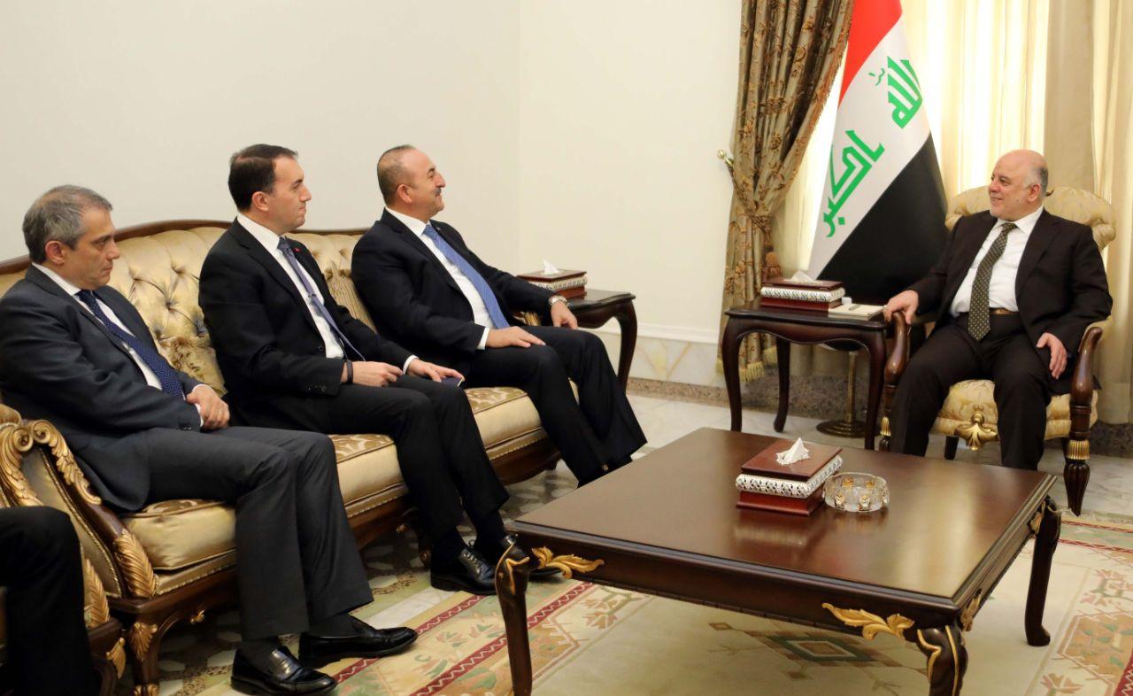 العبادي وأغلو يؤكدان على تعزيز العلاقات بين العراق وتركيا