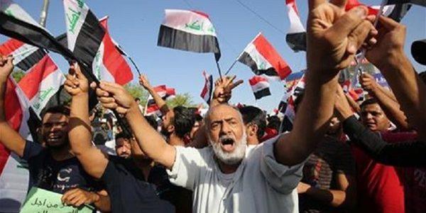 متظاهروا العراق يطالبون بتغيير النظام السياسي