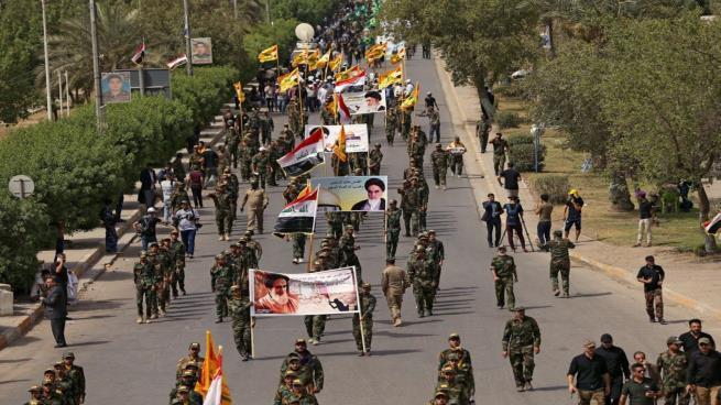 تقرير أمريكي:بقاء الحشد الشعبي يهدد أمن وأستقرار العراق لأنه عبارة عن شبكة جاسوسية إجرامية عسكرية إيرانية